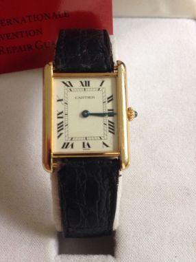 Reloj de pulsera Cartier, modelo Tank, oro 18kl